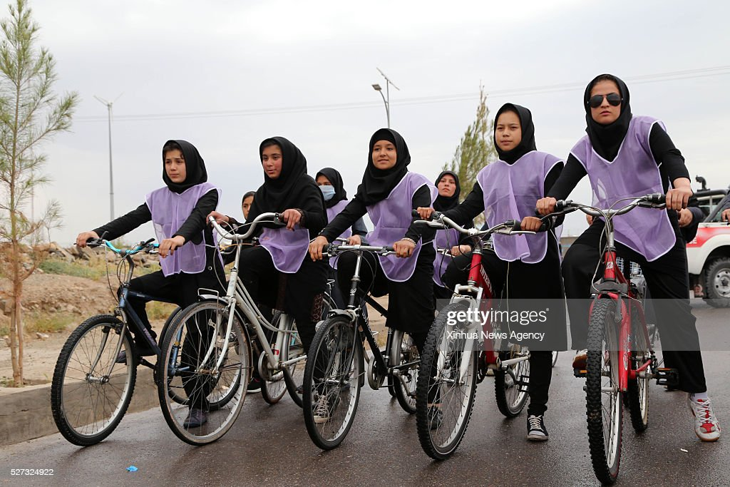 HERAT, May 2, 2016-- An Afghan women cyclist team take a break during a cycle event in Herat province, Afghanistan, May 2, 2016. Some 25 female cyclists took part in a cycling competition in Herat province, west of Afghanistan to demonstrate against gender discrimination.