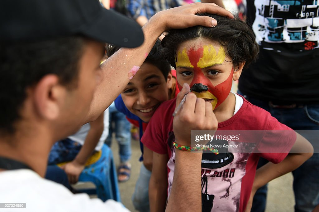 CAIRO, May 2, 2016-- An Egyptian boy has color oil painted on his face in a park in Cairo, Egypt on May 2, 2016. Falling on the first Monday after the Coptic Easter, the Sham el-Nessim, literally translated as 'Smell the Breeze', is a traditional Egyptian festival dating back to the age of Pharaoh that signifies the arrival of spring.