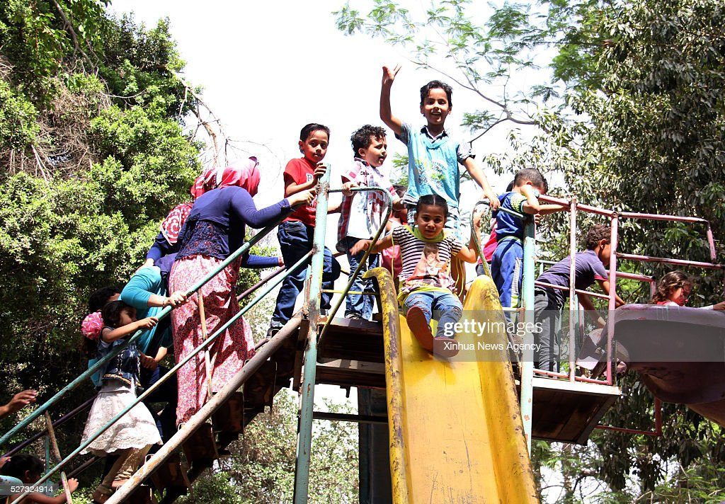 CAIRO, May 2, 2016 -- Children play on the slide as they celebrate the Sham el-Nessim in a park in Cairo, Egypt on May 2, 2016. Falling on the first Monday after the Coptic Easter, the Sham el-Nessim, literally translated as 'Smell the Breeze', is a traditional Egyptian festival dating back to the age of Pharaoh that signifies the arrival of spring.