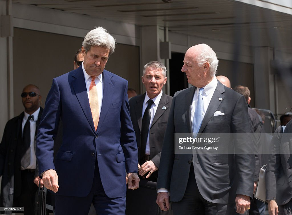 GENEVA, May 2, 2016-- U.S. Secretary of State John Kerry, left front, and UN Special Envoy for Syria Staffan de Mistura, right front, arrive for a press conference after their meeting in a hotel in Geneva, Switzerland, May 2, 2016. U.S. Secretary of State John Kerry on Monday urged all parties to the Syrian conflict to end violence and restore the cessation of hostilities during his second day trip here for talks focusing on the Syrian situation.