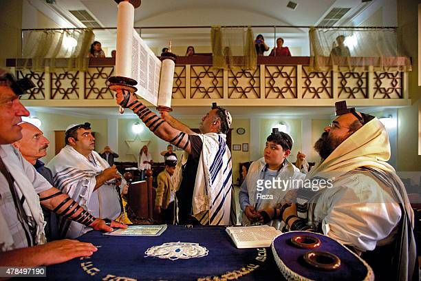 May 20 Baku Azerbaijan During a Bar Mitzvah the Torah is held up to the congregation The men wear tefillin two small leather boxes attached to...