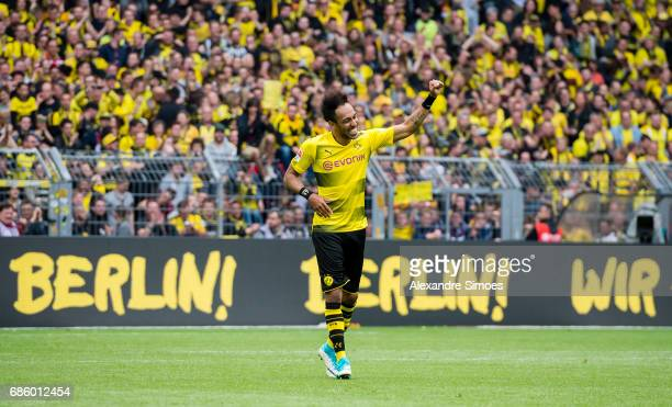 DORTMUND GERMANY May 20 PierreEmerick Aubameyang of Borussia Dortmund celebrates being the top scorer of this season after the final whistle during...
