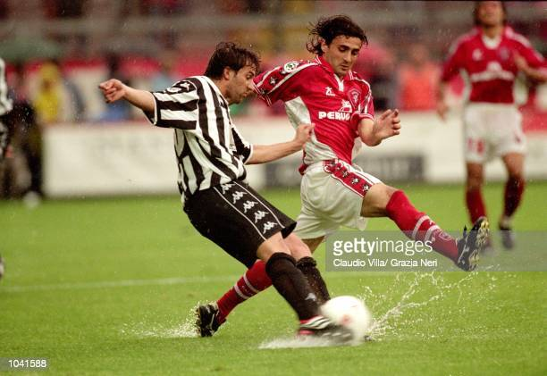 Alessandro Del Piero of Juventus passes the ball as Giovanni Tedesco of Perugia closes in during the Italian Serie A match at the Stadio Curi A in...