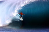 Andy Irons of Hawaii in action to win first place in the qualifly rounds of the Gotcha Pro Tahiti held in Teahupoo Tahiti French Polynesia DIGITAL...