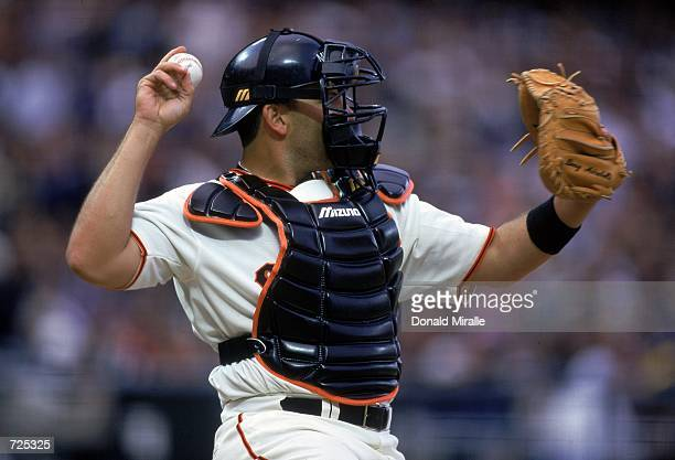 Catcher Doug Mirabelli of the San Francisco Giants tosses the ball to the pitcher during a game against the New York Mets at Pac Bell Park in San...