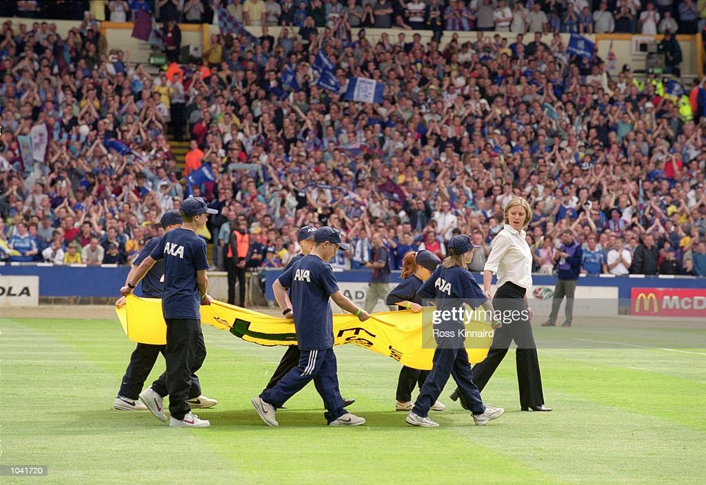 Children bring out the Fair Play flag before the AXA FA Cup Final 2000 Match between Aston Villa and Chelsea at Wembley Stadium, London, England. Chelsea won 1-0. \ Mandatory Credit: Ross Kinnaird /Allsport