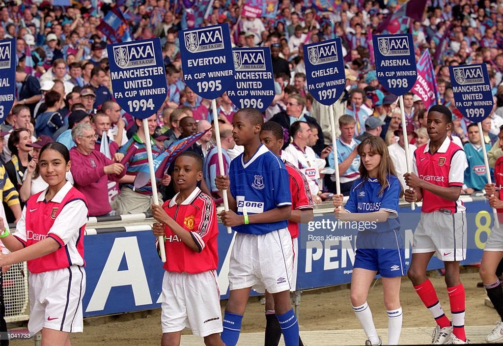 Children wear and hold previous cup winners shirts and AXA boards before the AXA FA Cup Final 2000 Match between Aston Villa and Chelsea at Wembley Stadium, London, England. Chelsea won 1-0. \ Mandatory Credit: Ross Kinnaird /Allsport