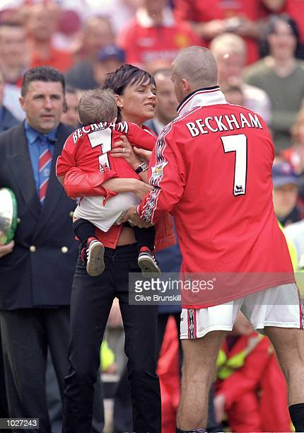 David Beckham of Manchester United with wife Victoria Posh Spice and son Brooklyn joining in the championship winning celebrations after the FA...