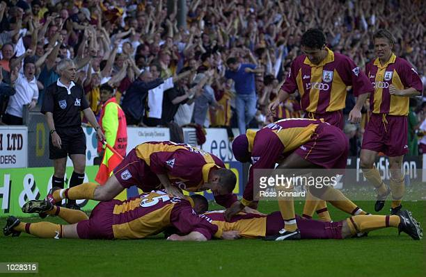 David Weatherall of Bradford celebrates with teammates after scoring the opening goal during the Bradford City v Liverpool FA Carling Premiership...