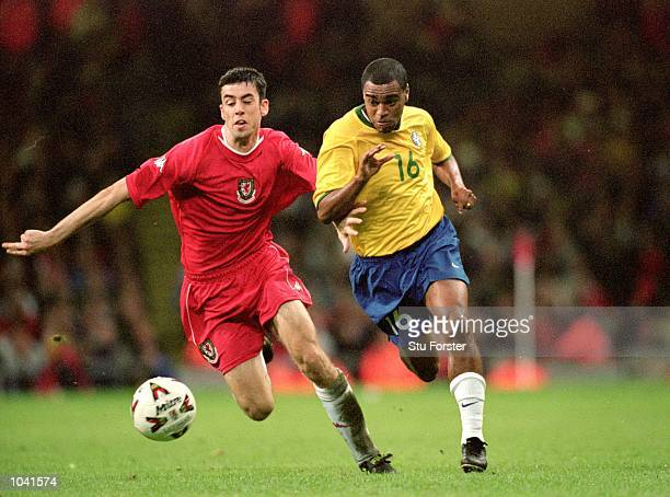 Denilson of Brazil beats Mark Delaney of Wales during the International Friendly match at the Millennium Stadium in Cardiff Wales Brazil won the...