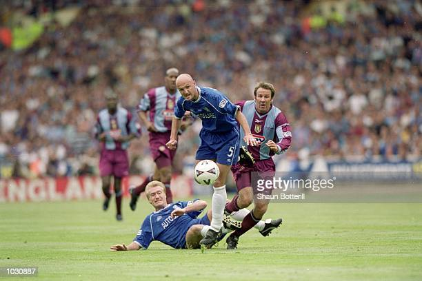 Didier Deschamps and Frank Leboeuf of Chelsea challenge Paul Merson of Aston Villa during the FA Cup final at Wembley Stadium in London Chelsea won...