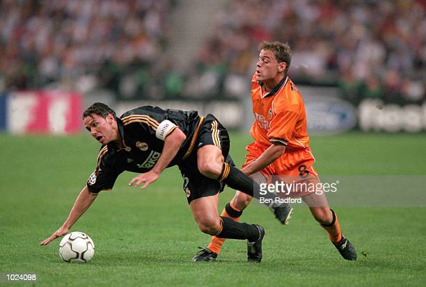 Fernando Redondo of Real Madrid is fouled by Farinos of Valencia during the European Champions League Final 2000 at the Stade de France SaintDenis...
