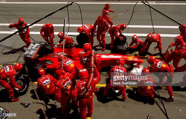 Ferrari pit lane crew in action during the Spanish Grand Prix at the Circuit de Catalunya in Barcelona Spain Mandatory Credit Mark Thompson /Allsport