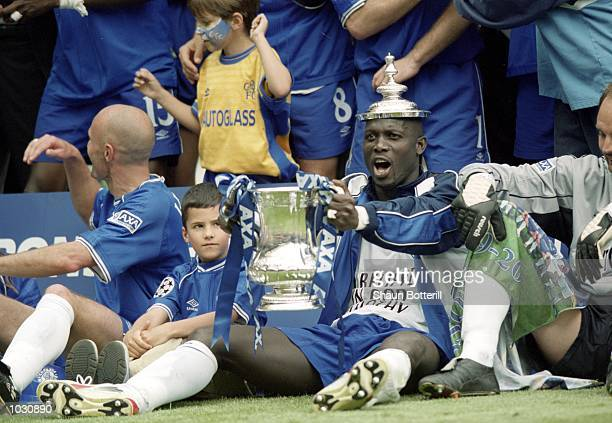 George Weah of Chelsea celebrates with the FA Cup after the final against Aston Villa at Wembley Stadium in London Chelsea won the match 10 Mandatory...