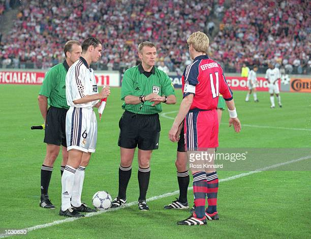 Referee Graham Poll with captains Redondo of Real Madrid and Stefan Effenberg of Bayern Munich during the Champions League semifinal second leg at...