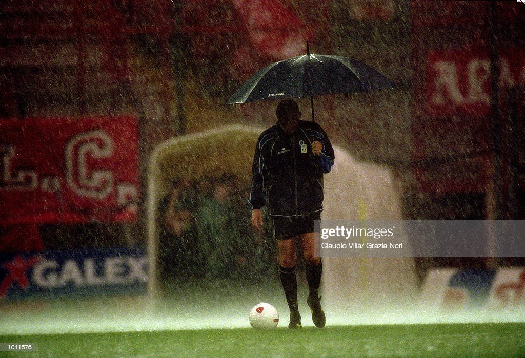 Referee Pierluigi Collina tests waterlogged pitch during the Italian Serie A match between Perugia and Juventus at the Stadio Curi A, in Perugia, Italy. Perugia won the match 1-0. \ Mandatory Credit: Claudio Villa /Allsport