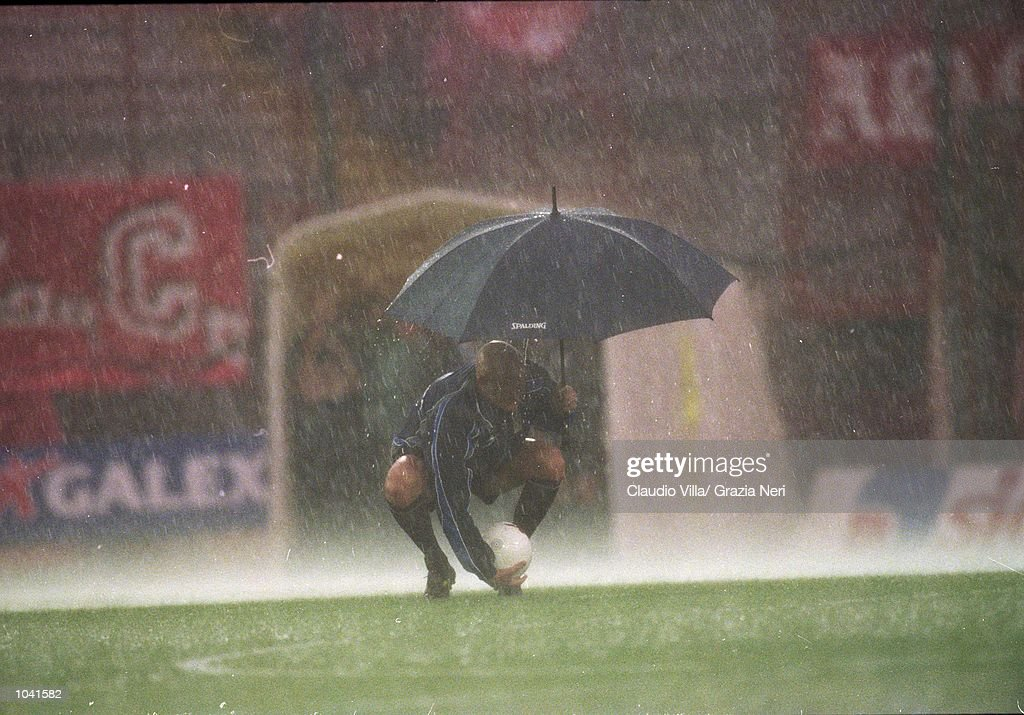 Referee Pierluigi Collina tests waterlogged pitch during the Italian Serie A match at the Stadio Curi A, in Perugia, Italy. Perugia won the match 1-0. \ Mandatory Credit: Claudio Villa /Allsport