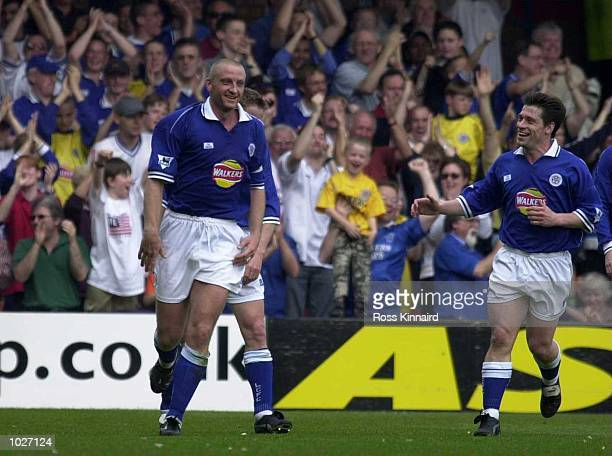The Leicester fans celebrate as Tony Cottee runs in to congratulate Matt Elliott on scoring his second goal during the Leicester City v Bradford City...