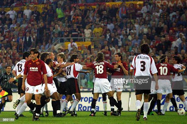 A melee breaks out during the AS Roma v AC Milan Serie A match played at the Olympic Stadium in Rome Mandatory Credit Grazia Neri/ALLSPORT