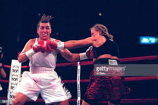 Christy Martin lands a chest punch during the fight against Kathy Collins at Madison Square Garden in New York New York Martin defeated Collins in...