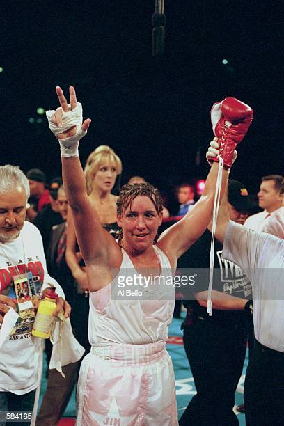 Christy Martin raises her arms in victory after the fight against Kathy Collins at Madison Square Garden in New York New York Martin defeated Collins...