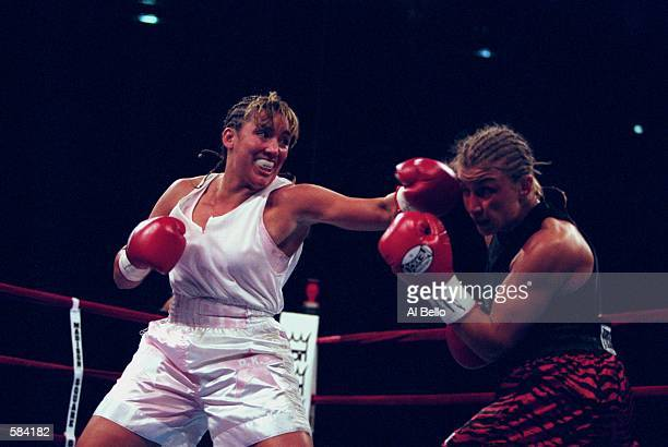 Christy Martin throws a left cross during the fight against Kathy Collins at Madison Square Garden in New York New York Martin defeated Collins in...