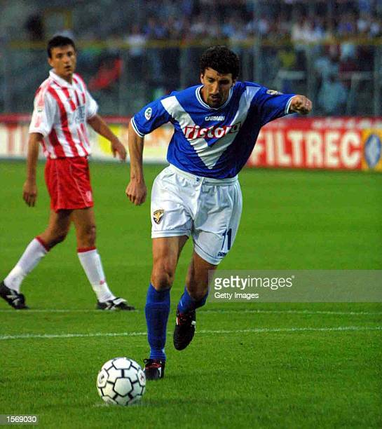 Dario Hubner of Brescia scores a penalty during the Serie A 30th Round League match between Brescia and Vicenza played at the Mario Rigamonti Stadium...