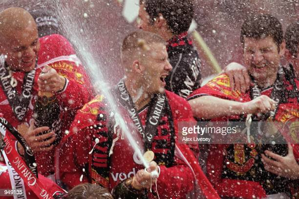 David Beckham of Manchester United celebrates winning the league title with teammates after the FA Carling Premiership match against Derby County...