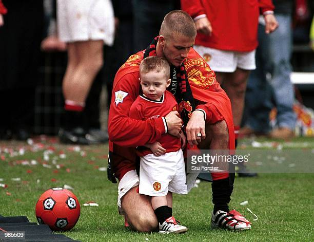 David Beckham with Brooklyn aftre the FA Carling Premiership match between Manchester United and Derby County at Old Trafford Manchester Mandatory...