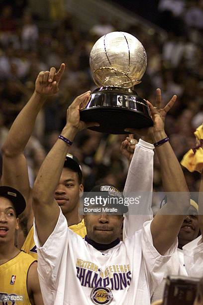 Derek Fisher of the Los Angeles Lakers holds the western conference trophy after scoring a gamehigh 28 points against the San Antonio Spurs in game...