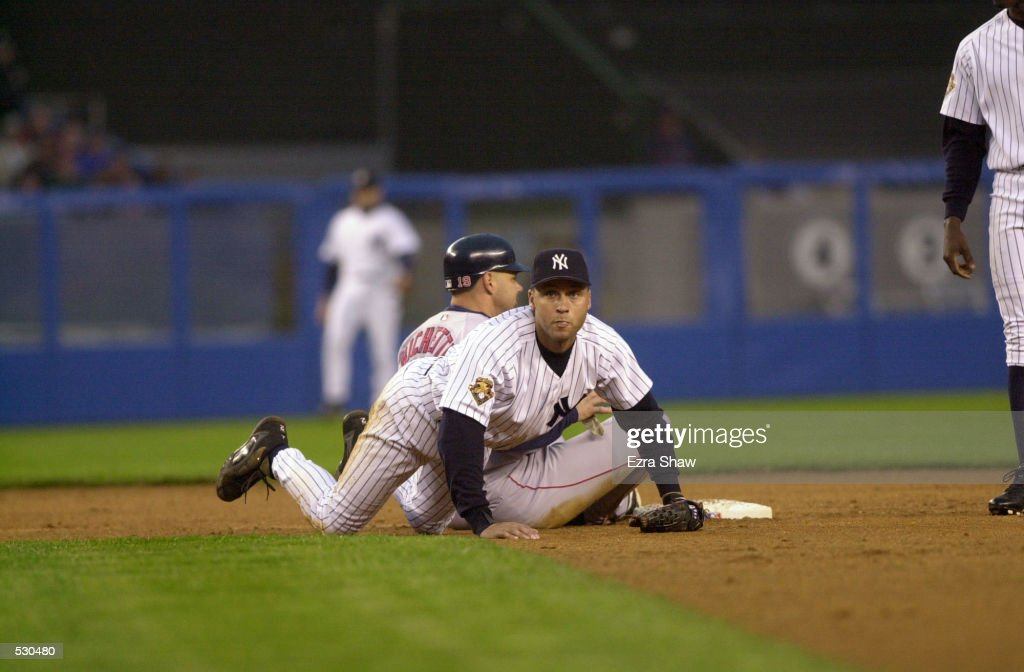 Derek Jeter of the New York Yankees helps himself up after leaping over Dante Bichette #19 of the Boston Red Sox during the game at Yankee Stadium in the Bronx, New York. The Yankees won 7-3. DIGITAL IMAGE. Mandatory Credit: Ezra Shaw/Allsport