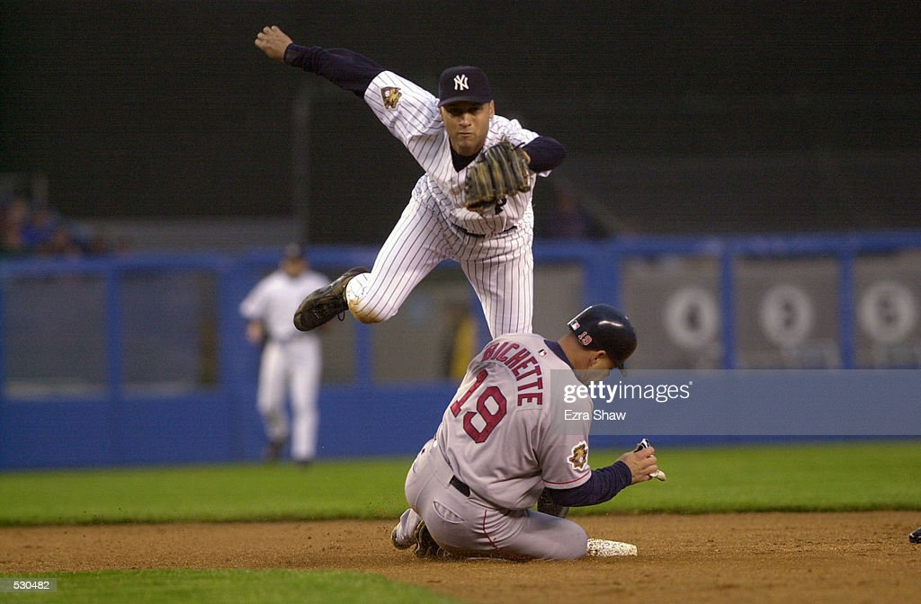 Derek Jeter of the New York Yankees turns a double play as he leaps over Dante Bichette #19 of the Boston Red Sox sliding into base during the game at Yankee Stadium in the Bronx, New York. The Yankees won 7-3. DIGITAL IMAGE. Mandatory Credit: Ezra Shaw/Allsport