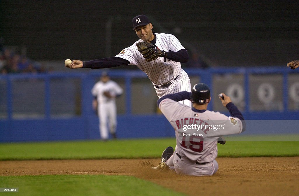 Derek Jeter of the New York Yankees turns a double play as Dante Bichette #19 of the Boston Red Sox slides into second during the game at Yankee Stadium in the Bronx, New York. The Yankees won 7-3. DIGITAL IMAGE. Mandatory Credit: Ezra Shaw/Allsport