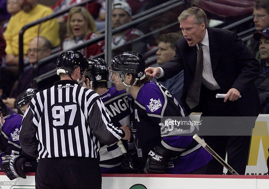 Head coach Andy Murray of the Los Angeles Kings expresses his point of view to linesman Jean Morin against the Colorado Avalanche during the third...