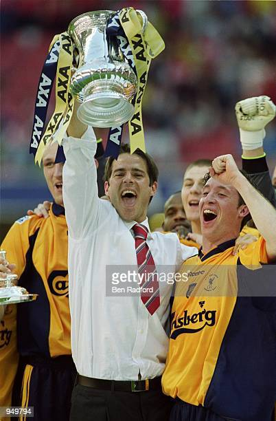 Jamie Redknapp and Robbie Fowler of Liverpool celebrate victory in the AXA Sponsored FA Cup Final against Arsenal at the Millennium Stadium in...