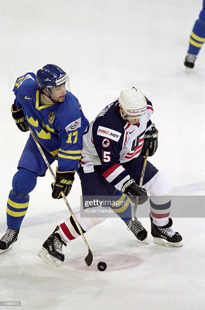 Jeff Helpern of USA (right) is challenged by Sweden's Mathias Johansson during the IIHF World Ice Hockey Championship Third place play-off match between Sweden and the USA played at the Preussag Arena in Hannover, Germany. \ Mandatory Credit: Stuart Franklin /Allsport
