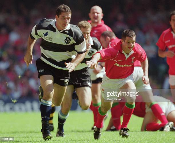 Joost Van Der Westhuizen of Barbarians leads the chase during the Scottish Amicable Tour match against Wales played at the Millennium Stadium in...