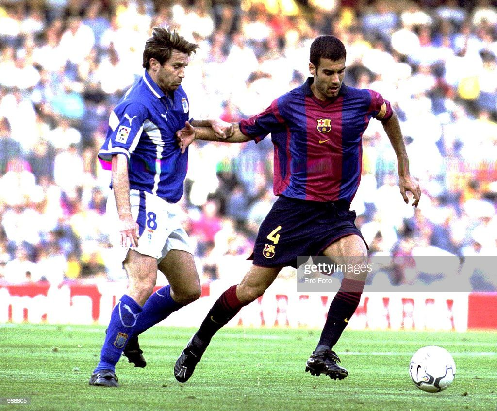 Josep Guaardiola of Barcelona holds off the challenge of Tomic of Oviedo during the Barcelona v Real Oviedo La Liga match played at the Nou Camp...