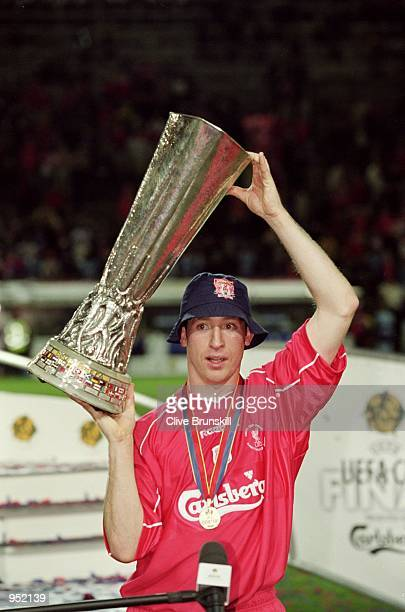 Liverpool captain Robbie Fowler lifts the UEFA Cup after the UEFA Cup Final against Alaves played at the Westfalenstadion in Dortmund Germany...