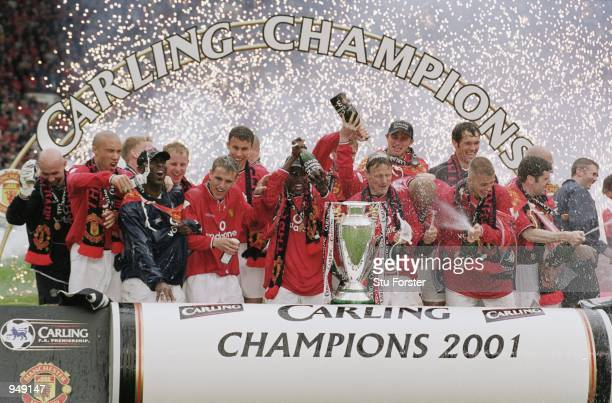 Manchester United celebrate winning the league title after the FA Carling Premiership match against Derby County played at Old Trafford in Manchester...