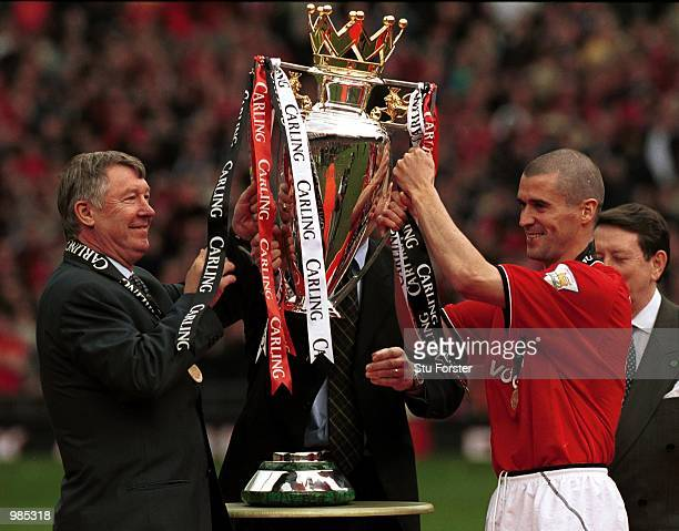Manchester United manager Sir Alex Ferguson and Roy Keane with the FA Carling Premiership trophy after the FA Carling Premiership match between...