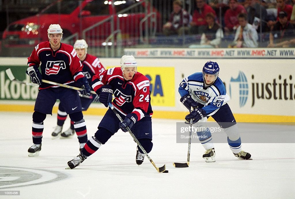 Mark Eaton of USA (left) in action during the IIHF World Ice Hockey Championships match against Finland played at the Preussag Arena in Hannover, Germany. \ Mandatory Credit: Stuart Franklin /Allsport