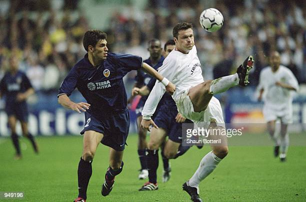 Mark Viduka of Leeds United holds the ball up against Mauricio Pellegrino of Valencia during the UEFA Champions League SemiFinals first leg match...