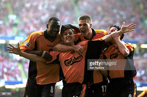 Michael Owen celebrates with his teammates after scoring the first goal for Liverpool during the AXA sponsored 2001 FA Cup Final between Arsenal v...