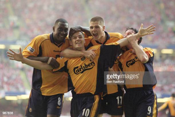 Michael Owen of Liverpool celebrates his equaliser with team mates Emile Heskey Steven Gerrard and Robbie Fowler in the AXA Sponsored FA Cup Final...