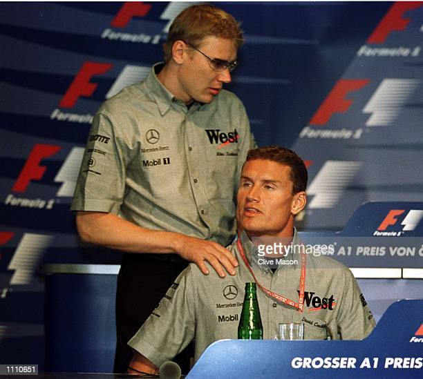 Mika Hakkinen of Finland and McLaren with David Coulthard of Great Britain at the pre race press conference for the Austrian Grand Prix at the A1...