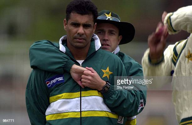 Pakistan captain Waqar Younnis is given a friendly hug from coach Richard Pybus during a net session at Trent Bridge Nottingham Digital Image...