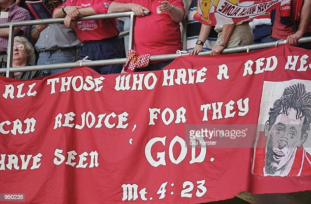 Robbie Fowler of Liverpool graces a flag dedicated to him by Liverpool fans during the AXA sponsored FA Cup Final against Arsenal played at the...