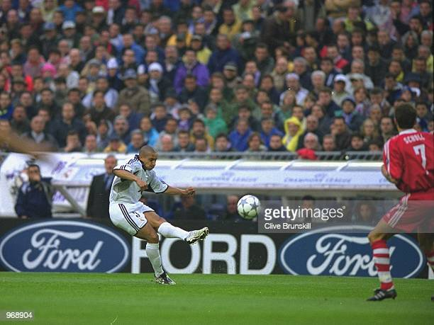 Roberto Carlos of Real Madrid clears the ball during the UEFA Champions League semifinal first leg match against Bayern Munich played at the Bernabeu...