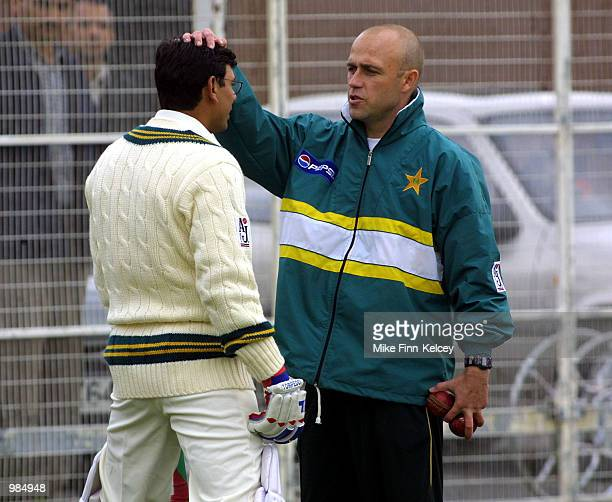 Saqlain Mustaq of Pakistan gets some last minute coaching from coach Richard Pybus during the friendly match against British Universities at Trent...